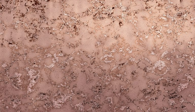 Rose gold paint on a rough background