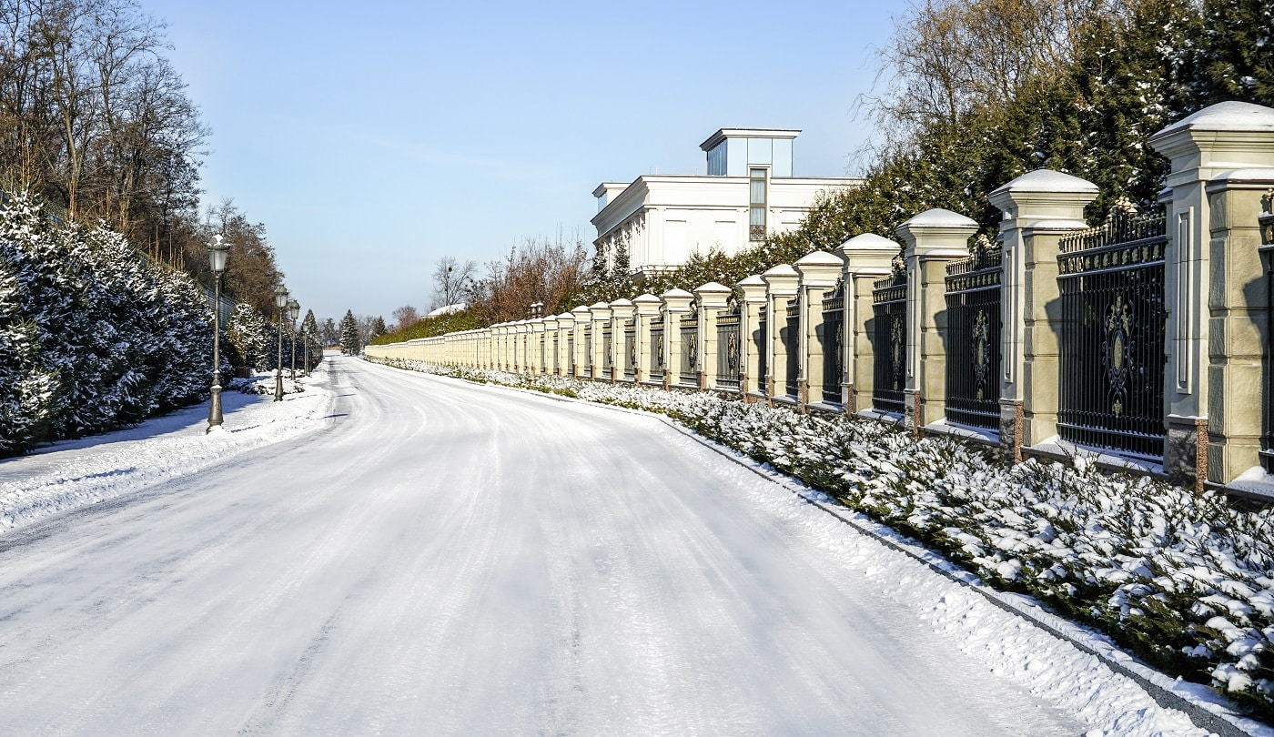 Road covered with snow on bright winter day