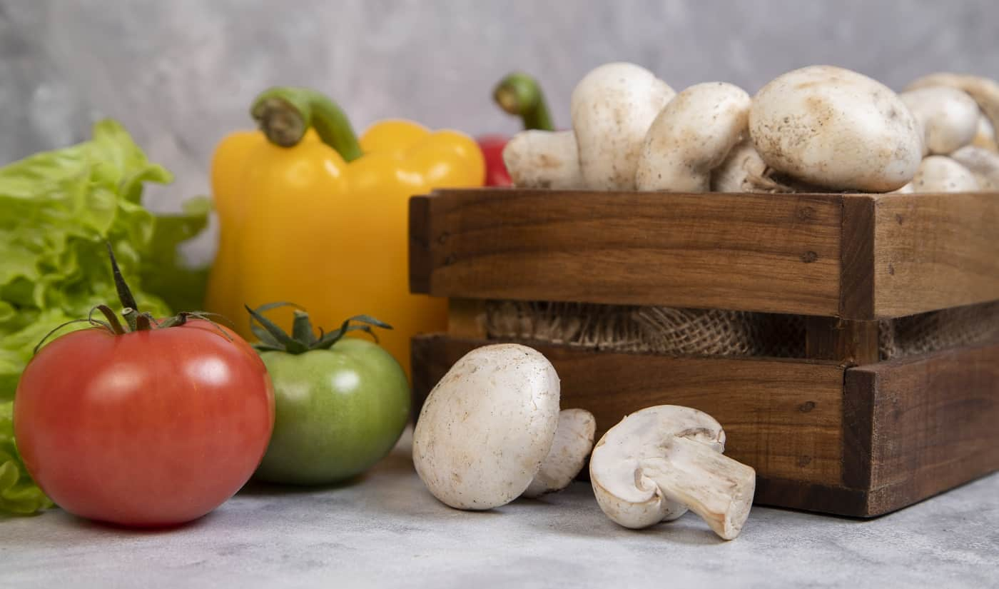 Various types of fresh healthy vegetables placed on a stone background . High quality photo