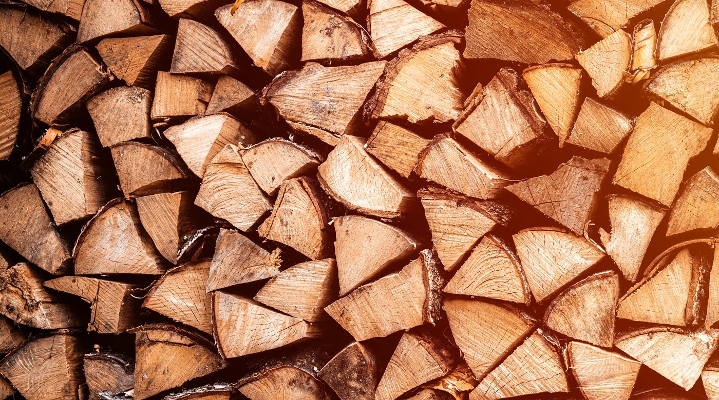 textured firewood background of chopped wood for kindling and heating the house. a woodpile with stacked firewood. the texture of the birch tree. banner. flare