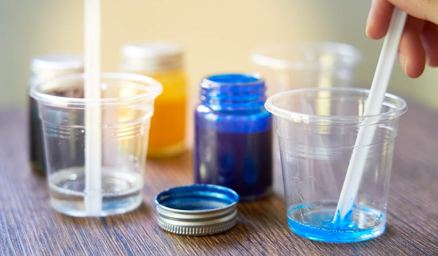 Mixing colorful of resin chemical in plastic cup, Process of making accessory from resin